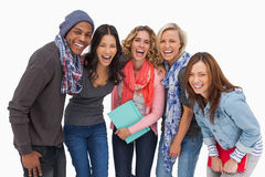 Fashionable students in a row smiling Stock Image