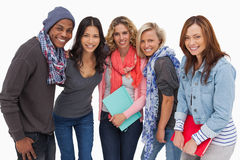 Fashionable students in a row. On white background Stock Photo