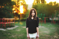 Fashionable stylish girl in black shirt outdoor during sunset Royalty Free Stock Images