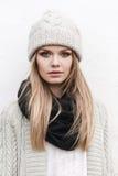 Fashionable stylish girl in white knit jacket Stock Photos