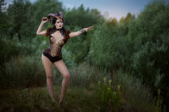 Fashionable stylish image of Capricorn. Modern female Capricorn stands in the woods, a fashionable and stylish image royalty free stock images