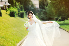 Fashionable stylish young brunette bride with bouquete Royalty Free Stock Image