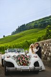 Fashionable and stylish young couple near the retro car, blonde girl in a lace dress and handsome man in trendy royalty free stock photo