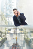 Fashionable successful business man on mobile phone call Stock Photos