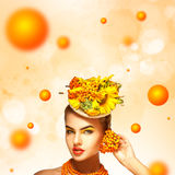 Fashionable summer portrait of beautiful young girl with rowan a Royalty Free Stock Images