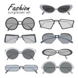 Fashionable sunglasses collection. Different shape spectacles. Colorful vector illustration set. Stock Photos