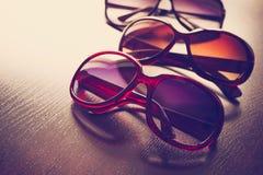 Fashionable sunglasses on desk. Stock Photos