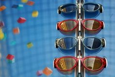 Fashionable sunglasses of different models on blue background stock image