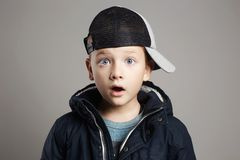 Fashionable surprised child.winter fashion Stock Image