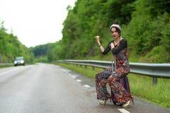Fashionable Swedish hitch-hiker Royalty Free Stock Image