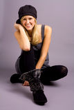 Fashionable Teenage Girl. Cute Blond Teenage Girl Wearing Fall Fashion including Boots and Hat Stock Photography