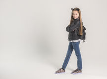 Fashionable teenage girl in a black jacket Royalty Free Stock Image