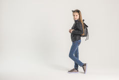 Fashionable teenage girl in a black jacket Stock Photos