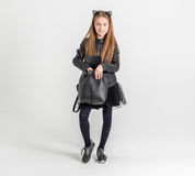 Fashionable teenage girl in a black jacket Royalty Free Stock Photography