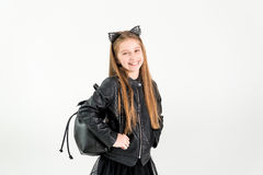 Fashionable teenage girl in a black jacket Royalty Free Stock Photos