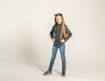 Fashionable teenage girl in a black jacket Stock Images