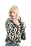 Fashionable teenage girl in fur coat. Isolated on white Stock Photography