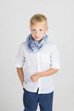 Fashionable teenager boy in blue scarf Stock Photography