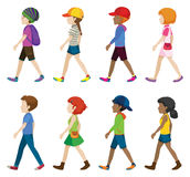 Fashionable teenagers walking Royalty Free Stock Images