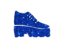 Fashionable tractor sole boot on high heel of blue glitter sparkle on white. Background Royalty Free Stock Images