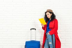 Fashionable traveler girl with suitcase is ready for trip. stock images