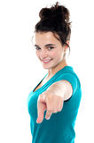 Fashionable trendy girl pointing towards camera Royalty Free Stock Photography
