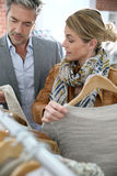 Fashionable trendy mature couple chopping for clothes Royalty Free Stock Image