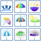 Fashionable umbrellas and a set of characters of different weath. Fashionable umbrellas and a set of icons of different weather within a framework on a white Royalty Free Stock Images