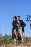 Fashionable vintage couple standing outside in romantic style Stock Photography