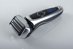 Fashionable Washable Electric Razor. Ultramodern Five Blades Electric Shaver On Smooth Reflecting Surface. Vertical Image Stock Photo