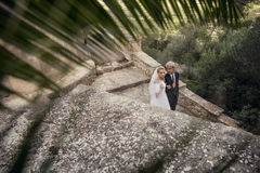 Fashionable wedding couple near Catholic church. Bride and Groom. Outdoor portrait Royalty Free Stock Images