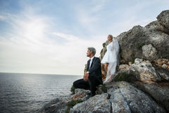 Fashionable wedding couple near ocean. Bride and Groom. Outdoor portrait Stock Photo