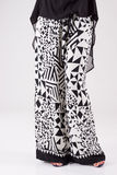 Fashionable white and black trousers with pattern. Royalty Free Stock Photos