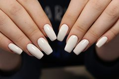 fashionable white manicure Royalty Free Stock Photography