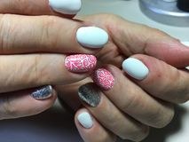 fashionable white manicure with silver design royalty free stock image