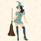 The fashionable witch with a sweeper Stock Photos