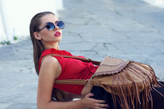 Fashionable woman. Beautiful stylish girl in red blouse and sunglasses Stock Photo