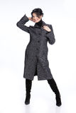 Fashionable Woman. Young woman in a raincoat on isolated background royalty free stock photos