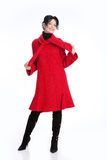 Fashionable Woman. Young woman in a raincoat on isolated background royalty free stock photography