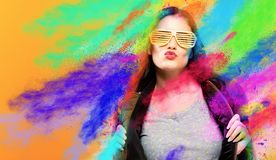 Fashionable woman with attitude. With coloful party splashes royalty free stock photo