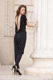 Fashionable woman in backless jumpsuit Stock Image