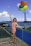 Fashionable woman with balloons Royalty Free Stock Images