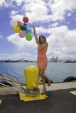 Fashionable woman with balloons Royalty Free Stock Image