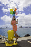 Fashionable woman with balloons Royalty Free Stock Photography