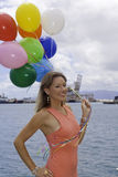 Fashionable woman with balloons Royalty Free Stock Photos