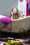 Fashionable woman in bathtub Royalty Free Stock Photo