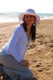 Fashionable woman on beach Stock Images