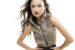 Fashionable woman. A beautiful woman wearing a fashionable vest Royalty Free Stock Photos