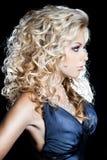 Fashionable woman on black background Stock Photo