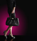 Fashionable woman with a black bag Royalty Free Stock Photography